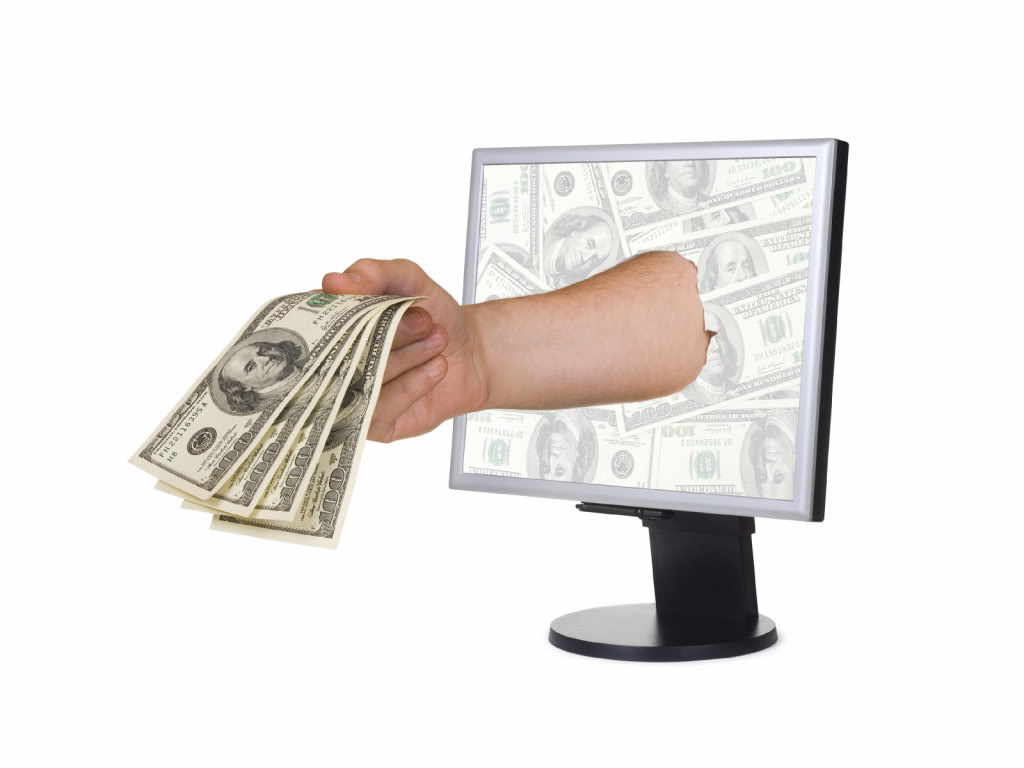 Hand with money and computer monitor, isolated on white background